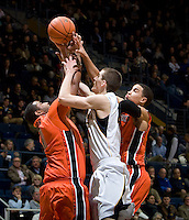 David Kravish of California tries to rebound a loose ball during the game against Oregon State Beavers at Haas Pavilion in Berkeley, California on January 31st, 2013.  California defeated Oregon State, 71-68.