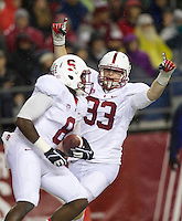 SEATTLE, WA - Stanford linebacker Trent Murphy, right, celebrated a defensive touch down with safety Jordan Richards September 28, 2013: Stanford against Washington State at CenturyLink Field. Stanford won 55-17
