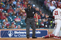 Home plate umpire Michael Banks makes a strike call during the NCAA baseball game between the Arkansas Razorbacks and the Oklahoma Sooners in game two of the 2020 Shriners Hospitals for Children College Classic at Minute Maid Park on February 28, 2020 in Houston, Texas. The Sooners defeated the Razorbacks 6-3. (Brian Westerholt/Four Seam Images)