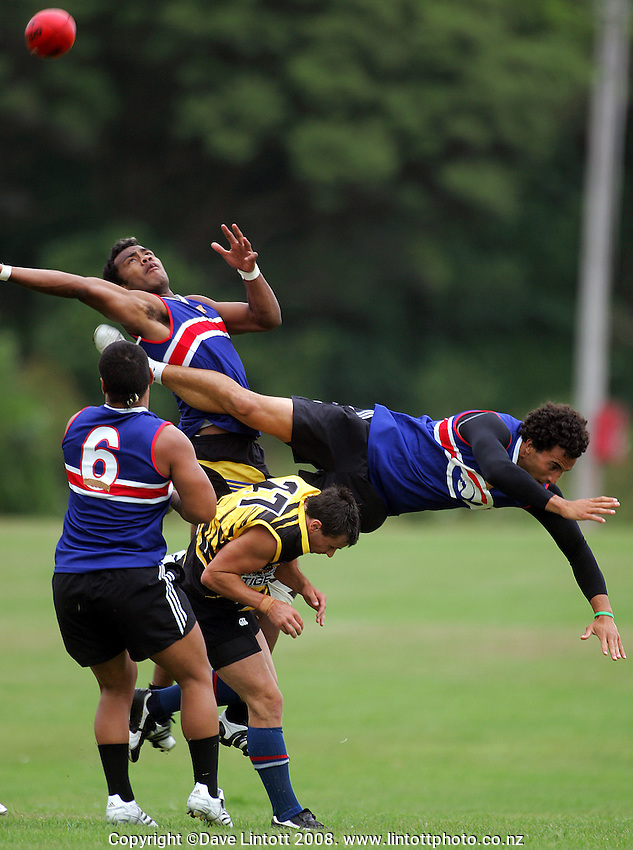 Players collide leaping for high ball during the Preseason Cross-code Rugby Union v Australian Rules friendly between the Hurricanes and Wellington Tigers at  Elsdon Park, Porirua, New Zealand on Tuesday, 15 January 2008. Photo: Dave Lintott / lintottphoto.co.nz