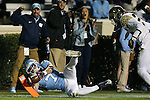 17 October 2015: UNC's Austin Proehl (7) is knocked out of bounds by Wake Forest's Brad Watson (right) at the one yard line. The University of North Carolina Tar Heels hosted the Wake Foresst University Demon Deacons at Kenan Memorial Stadium in Chapel Hill, North Carolina in a 2015 NCAA Division I College Football game. UNC won the game 50-14.