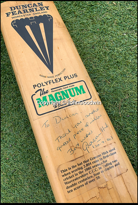 BNPS.co.uk (01202 558833)<br /> Pic JohnGoodwin/BNPS<br /> <br /> Graham Hicks Fearnley bat from his record breaking season for Worcs'.<br /> <br /> Legendary bat maker is selling up his historic collection of willow wonders.<br /> <br /> A collection of cricket bats that were used by some of finest players of all-time have been put up for sale by the man who crafted them with his own hands.<br /> <br /> Duncan Fearnley, 79, is best known for producing bats for legendary England all-rounder Ian Botham throughout his illustrious career.<br /> <br /> He also created hand-made blades for the likes of Viv Richards, Clive Lloyd and Indian hero Sunil Gavaskar, all featuring his famous 'three stump' logo.<br /> <br /> At the end of a season the bats were often donated back to him by generous players and he has now decided to part with a number of them.