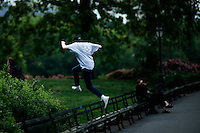 A man jumps a bench at central park in New York.  06/05/2015. Eduardo MunozAlvarez/VIEWpress