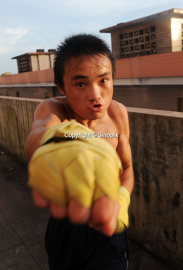 Li Le Fa, 15, in Huili Middle School in Sichuan Province, China. The group of young boxers are hoping to make it to become some of China's first professional boxers...PHOTO BY SINOPIX