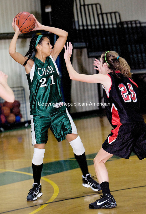 WATERBURY, CT - 22 DECEMBER 2009 -122209JT06--<br /> Chase's Onyesanom Nolisa looks for a pass around Hun School of Princeton's Nicole Campellone during Tuesday's game at Chase in which Chase won. <br /> Josalee Thrift Republican-American