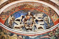 Frescoes depicting Christ Pantocrator with the symbols of the four evangelists on either side on the interior of the Romanesque Baptistery of Parma, circa 1196, (Battistero di Parma), Italy