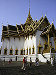 Visitors walk past a temple in the Grand Palace Complex depart a temple in Bangkok, Thailand. (Jim Bryant Photo).....