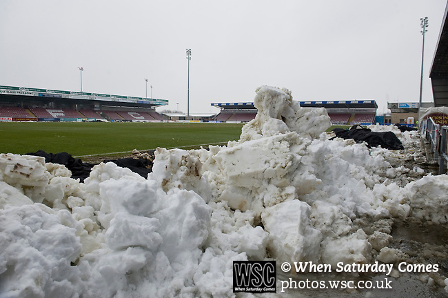 Northampton Town 1 Oxford United 0, 23/03/2013. Sixfields, League Two. Oxford United are the visitors to Sixfields as the long British winter continues in Northamptonshire. Snow is cleared and piled at the side of the pitch. Photo by Simon Gill