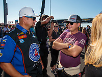 Sep 3, 2018; Clermont, IN, USA; NHRA funny car driver Robert Hight (left) talks with top fuel driver Steve Torrence during the US Nationals at Lucas Oil Raceway. Mandatory Credit: Mark J. Rebilas-USA TODAY Sports