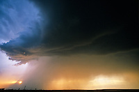 Sunset behind rain shaft falling from severe thunderstorm on Great Plains West of Hobbs; New Mexico, AGPix_0067.
