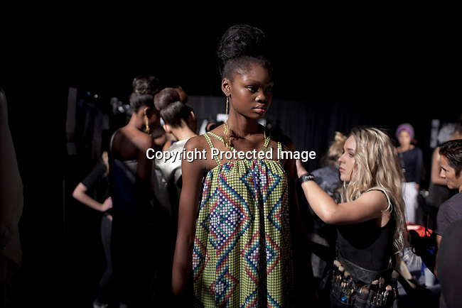 CAPE TOWN, SOUTH AFRICA AUGUST 10: Favour Lucky, a 15-year old Nigerian model, waits backstage before a fashion show on August 10, 2013 in Cape Town, South Africa. She won Nigeria's next supermodel and has worked at fashion weeks in Johannesburg, Cape Town, New York and others. She walked in several shows at Mercedes Benz Cape Town Fashion Week where some of South Africa's finest designers showed their 2012-13 spring and summer collections during the 4-day event (Photo by: Per-Anders Pettersson)