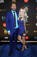 08 March 2019 - Las Vegas, NV - Daniel Negreanu, Amanda Leatherman.  2019 One Night for One Drop blue carpet arrivals at Bellagio Las Vegas. Photo Credit: MJT/AdMedia