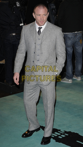 "GUY RITCHIE.The World Premiere of ""Sherlock Holmes"", Empire cinema Leicester Square, London, England..December 14th, 2009.arrivals full length suit waistcoat grey gray suit black tie wool shoes hand in pocket .CAP/CAN.©Can Nguyen/Capital Pictures."