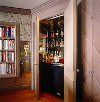 A well stocked bar is concealed behind a mirrored door in the drawing room