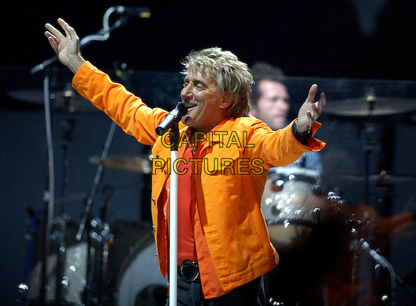 """ROD STEWART .performs live at The Pond of Anaheim as part of his """"From Maggie May To The Great American Songbook.44-City Tour"""" .22 March 2004.*UK Sales Only*.live, music, singing, stage, concert, gig, orange jacket.www.capitalpictures.com.sales@capitalpictures.com.©Capital Pictures. ."""