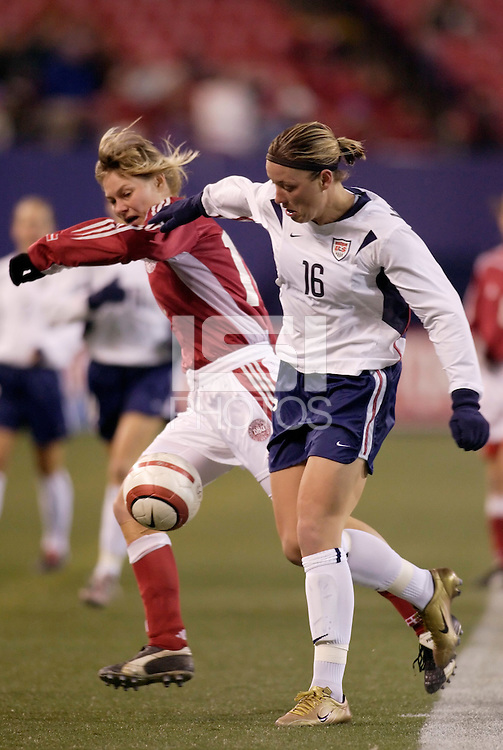 "USA's Abby Wambach battles Anne Dot Eggers of Denmark for the ball. The US Women's National Team tied the Denmark Women's National Team 1 to 1 during game 8 of the 10 game the ""Fan Celebration Tour"" at Giant's Stadium, East Rutherford, NJ, on Wednesday, November 3, 2004.."