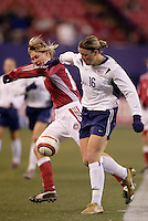 """USA's Abby Wambach battles Anne Dot Eggers of Denmark for the ball. The US Women's National Team tied the Denmark Women's National Team 1 to 1 during game 8 of the 10 game the """"Fan Celebration Tour"""" at Giant's Stadium, East Rutherford, NJ, on Wednesday, November 3, 2004.."""