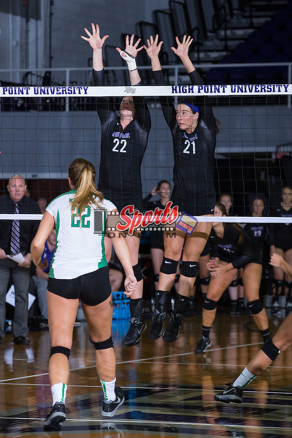 Molly Livingston (22) and Camryn Freiberg (21) of the High Point Panthers attempt a blcom during the match against the Marshall Thundering Herd at the Panther Invitational at the Millis Athletic Center on September 12, 2015 in High Point, North Carolina.  The Thundering Herd defeated the Panthers 3-2.   (Brian Westerholt/Sports On Film)
