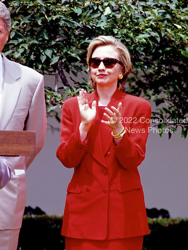 First lady Hillary Rodham Clinton applauds as United States President Bill Clinton speaks to members of the League of Women Voters in the Rose Garden of the White House in Washington, D.C. on June 7, 1993.<br /> Credit: Ron Sachs / CNP