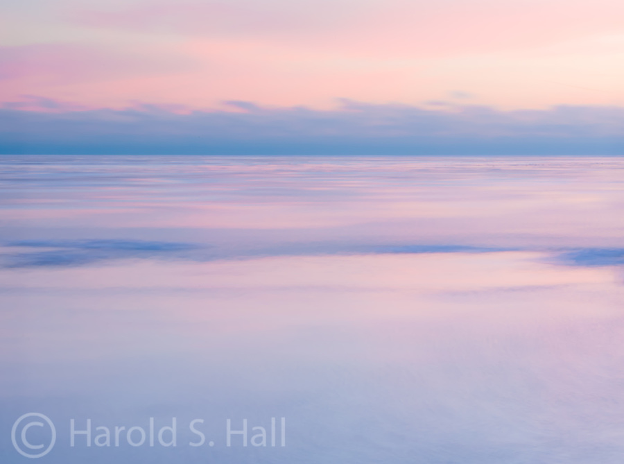 Soft light and soft edges of a sunrise over Lake Michigan.