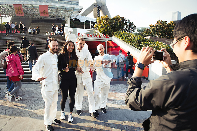 The Tour de France champions were initiated into the ancestral practice of Tai Chi at the foot of the monumental Shanghai Oriental Pearl Tower, before the 2017 Tour de France Skoda Shanghai Criterium, Shanghai, China. 28th October 2017.<br /> Picture: ASO/Pauline Ballet | Cyclefile<br /> <br /> <br /> All photos usage must carry mandatory copyright credit (&copy; Cyclefile | ASO/Pauline Ballet)