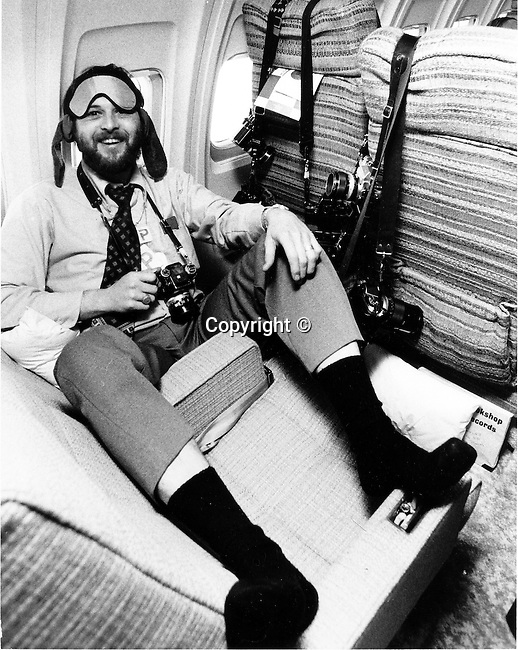Photojournalist Ron Bennett clowns around in his seat on Air Force One,