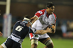 Ulster number 8 Nick Williams hands off Blues flanker Robin Copeland..RaboDirect Pro12.Cardiff Blues v Ulster Rugby.Cardiff Arms Park.28.09.12.©Steve Pope