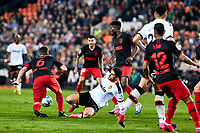 14th February 2020; Mestalla, Valencia, Spain; La Liga Football,Valencia versus Atletico Madrid; Guedes of Valencia CF loses the ball surrounded and challenged by atletico defence