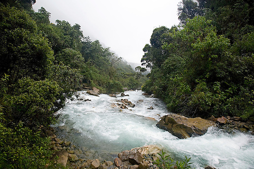 THE ROARING RIO SANTA TERESA FLOWS THROUGH THE PERUVIAN ANDES