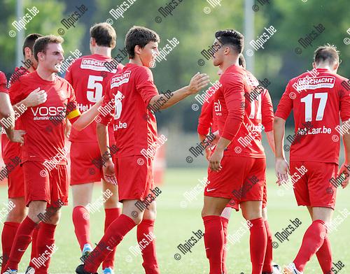 2014-08-02 / Voetbal / seizoen 2014-2015 / FC Turnhout - Vosselaar / Aanvoerder Maarten Sas en Pieter Engelen feliciteren Glenn Jansen met zijn doelpunt (0-1)<br /><br />Foto: mpics.be