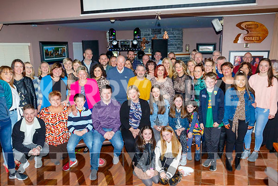 Donna Dennehy from Currow, seated centre, got a great surprise last Saturday night when she walked into O'Riada's bar, Ballymac to find a massive group waiting to celebrate her 40th birthday with her.