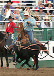 Wyatt Cox competes in the team roping event at the Reno Rodeo in Reno, Nev. on Friday, June 19, 2015.<br /> Photo by Cathleen Allison/Nevada Photo Source