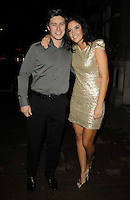 Tony Discipline & Jacqueline Jossa.attended the Kensington Club new boutique nightclub launch party, The Kensington Club, High Street Kensington, London, England,.20th July 2012..full length grey gray shirt gold dress black belt trousers  arm around sequined sequin .CAP/CAN.©Can Nguyen/Capital Pictures.