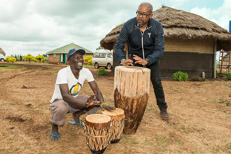 Forest Whitaker and Sam Kelo Okello jam on the drums at Hope North, Uganda.