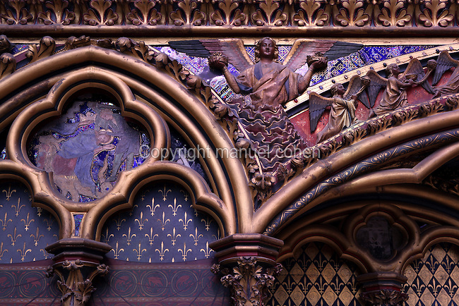Detail of a winged angel sculpture decoration on Saint Louis' recess in the Upper chapel of La Sainte-Chapelle (The Holy Chapel), 1248, Paris, France. Saint Louis's recess is decorated with golden fleur de lys on a blue background. La Sainte-Chapelle was commissioned by King Louis IX of France to house his collection of Passion Relics, including the Crown of Thorns. The Sainte-Chapelle is considered among the highest achievements of the Rayonnant period of Gothic architecture. Picture by Manuel Cohen