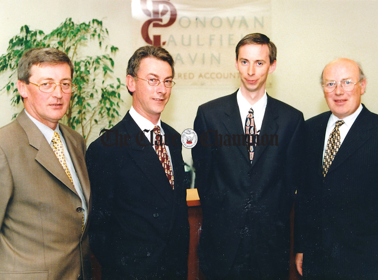 Kilrush man, Richard Maguire, second from right, has been admitted as a new partner to the firm of O'Donovan Caulfield Lavin Chartered Accountants. He is pictured with his new associates, from left, Pat Lavin, Jim O'Donovan and Tom Caulfield - May 26, 2000.