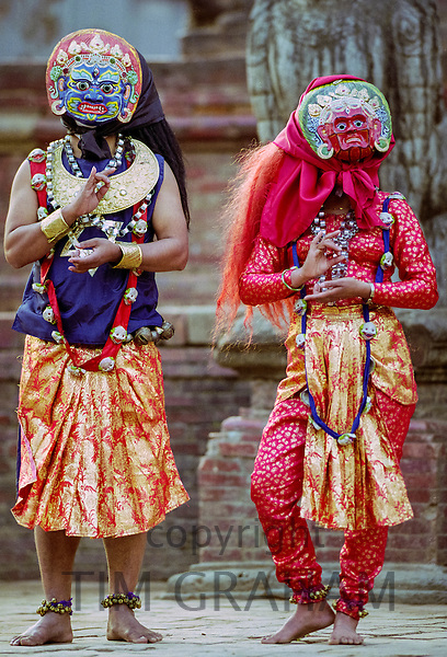 Male and female dancers at cultural event in Bhaktapur, Nepal