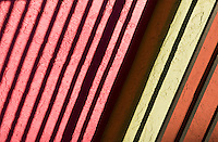 light and shadow patterns from hand rail and bright colors in La Placitas Village.