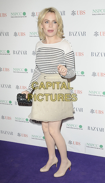 DUFFY (AIMEE ANN DUFFY).The Surrealist Ball in aid of NSPCC at The Banqueting House, London, England..March 17th, 2011.full length beige sheer skirt white blue black stripe top nautical clutch bag shoes .CAP/CAN.©Can Nguyen/Capital Pictures.