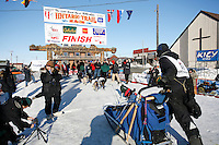 Friday March 16, 2007  - Nome, Alaska ----   Rookie Tom Lesatz runs under the burl arch finish line in Nome in 39th place.