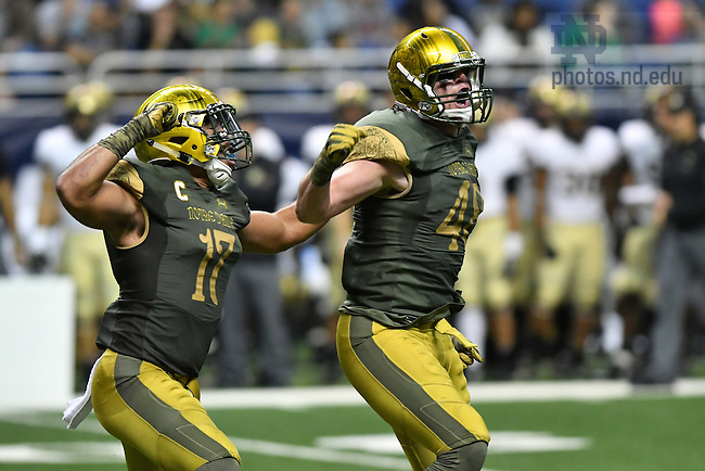 November 12, 2016; Irish linebacker Greer Martini (48) celebrates a sack with linebacker James Onwualu (17) in the third quarter against the Army Black Knights at the Alamodome. Notre Dame won 44-6. (Photo by Matt Cashore)