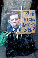 "Poster with Spanish prime Minister Mariano rally's face  entitle ""Trump, i do it well""."