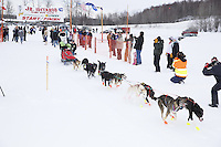 Malilnda Tjelta and dog team leaves the start line of the 2013 Junior Iditarod on Knik Lake.  Knik Alaska..Photo by Jeff Schultz/IditarodPhotos.com   Reproduction prohibited without written permission