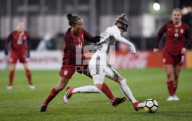 Columbus, Ohio - Thursday March 01, 2018: Mallory Pugh, Verena Faißt during a 2018 SheBelieves Cup match between the women's national teams of the United States (USA) and Germany (GER) at MAPFRE Stadium.