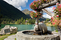 Switzerland, Canton Valais, Champex-Lac: resort and lake at 1.470 m, Tour du Mont Blanc one of the classic long-distance walking trails and The Ultra-Trail du Mont-Blanc passing this village | Schweiz, Kanton Wallis, Champex-Lac: Ferienort und See auf 1.470 m, Station des Fernwanderwegs Tour du Mont-Blanc und des Ultra-Marathons Ultra-Trail du Mont-Blanc