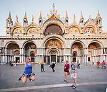 Joana jumps in the evening, San Marko Plaza and Basilica, Venice, Italy