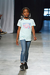 Model walks runway in an outfit from the Camp Spring Summer 2020 collection at City Point, on October 12, 2019, during Fashion Week Brooklyn Spring Summer 2020.