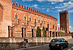 A bikerider passes the Hotel and Spa Castello di Carimate, a castle near Como, Italy that dates back to the mid 1300's