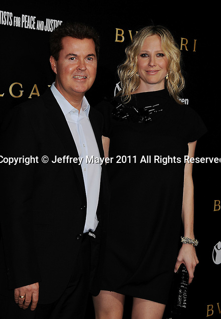 LOS ANGELES, CA - January 13: Simon Fuller (L) and Natalie Swanston attend Save The Children's U.S. Programs And Artists For Peace And Justice Hosted By Bulgari at Ron Burkle's Green Acres Estate on January 13, 2011 in Beverly Hills, California.