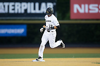 Bruce Steel (17) of the Wake Forest Demon Deacons steps on second as he rounds the bases after hitting a 2-run home run against the West Virginia Mountaineers in Game Four of the Winston-Salem Regional in the 2017 College World Series at David F. Couch Ballpark on June 3, 2017 in Winston-Salem, North Carolina.  The Demon Deacons walked-off the Mountaineers 4-3.  (Brian Westerholt/Four Seam Images)